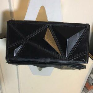 BCBGMaxAzria pyramid clutch in black